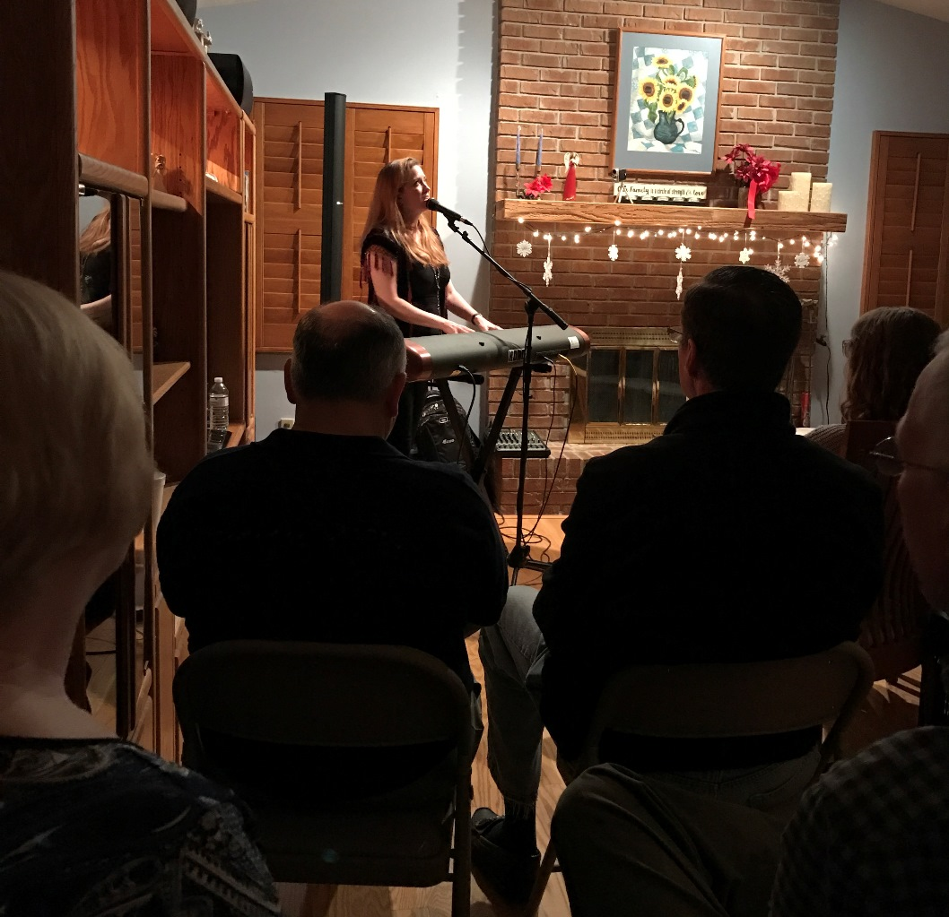Kira Small performs at a house concert hosted by Barbara and Mark Routen