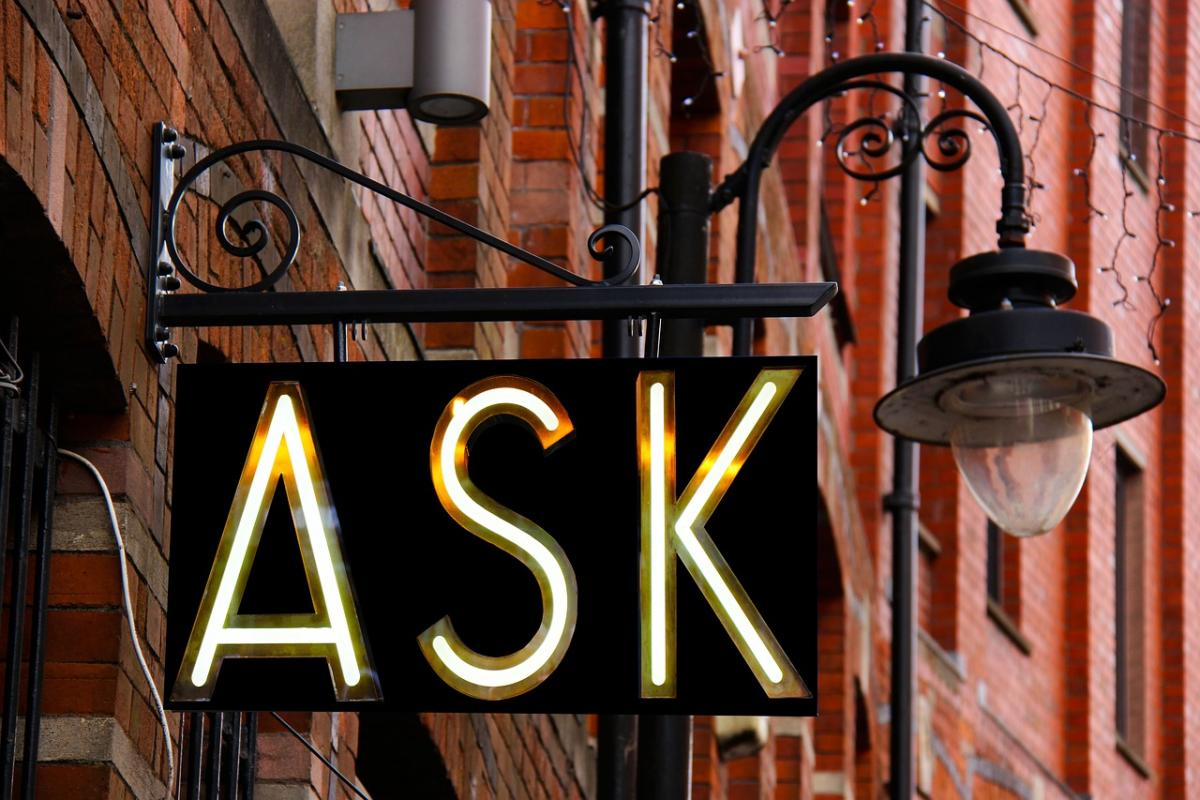 Ask sign on building wall