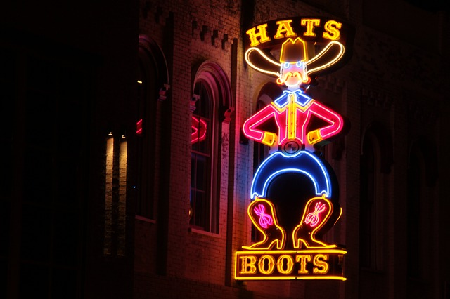 Hats boots neon sign in Nashville