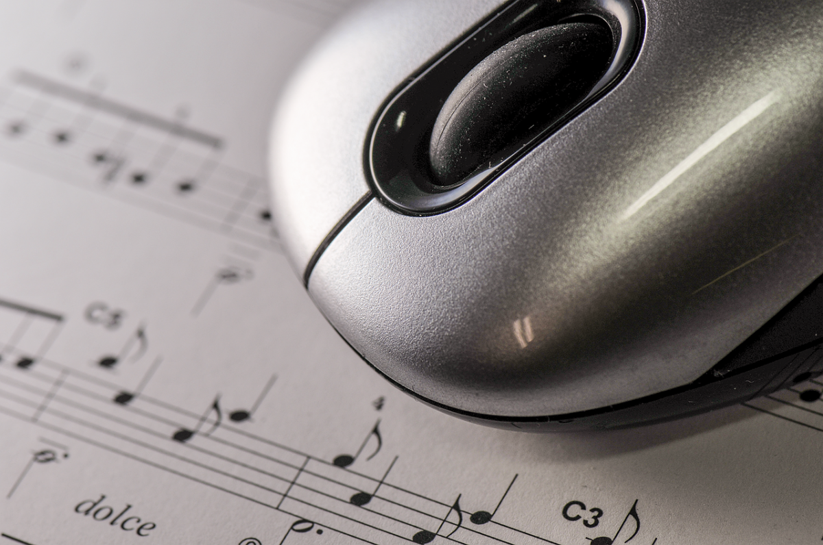 Computer mouse over sheet music