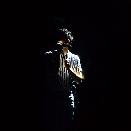 Singer on dark stage